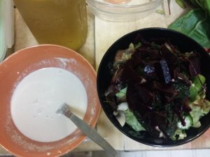 Cooked salad with sauce
